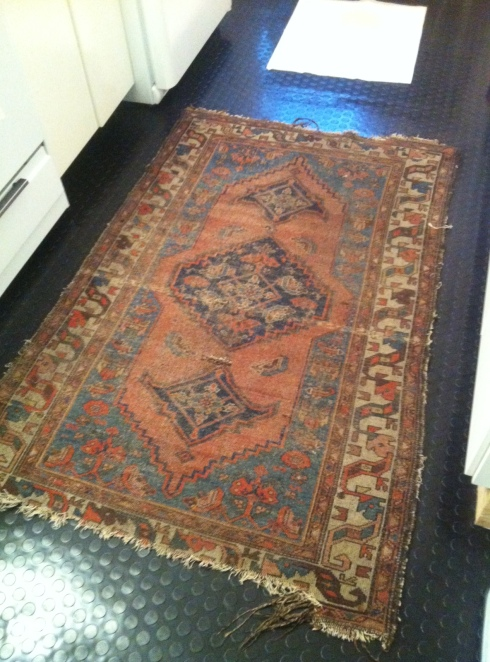 Daniel's gorgeous rug, in his new rubber-floored kitchen.
